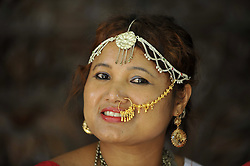 August 9, 2016 - Kathmandu, NE, Nepal - A smilling portrait of Nepalese Rajbansi girl in a traditional attire pose for the photo during the International Day of the 22nd World Indigenous Day celebrated in Kathmandu, Nepal, 09 August 2016. At the call of the United Nations, on August 9 every year the International Day of the World's Indigenous People observed by organizing different programs. (Credit Image: © Narayan Maharjan/NurPhoto via ZUMA Press)