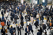 overhead view of commuting crowd in Tokyo Japan