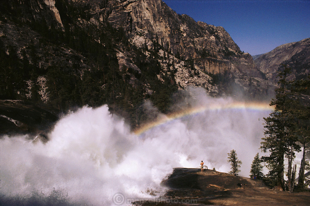 Rainbow at Waterwheel Falls on the Tuolumne River in Yosemite National Park, California. Marc Reisner, author of Cadillac Desert, looking at the rainbow. Photographed in 1980 prior to his writing the book.