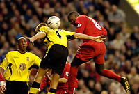 Photo. Jed Wee.<br /> Liverpool v Aston Villa, FA Barclaycard Premiership, Anfield, Liverpool. 10/01/2004.<br /> Liverpool's Emile Heskey (R) gets a vital touch on the ball to deflect it to Danny Murphy who opens the scoring.
