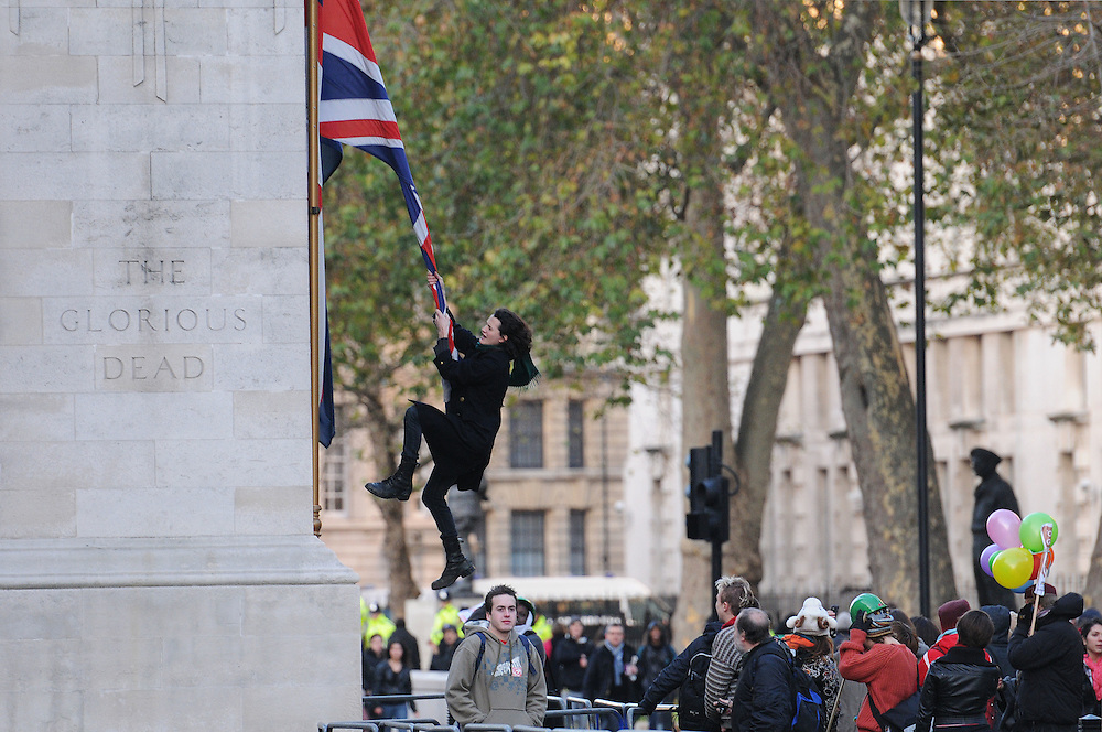 Charlie Gilmour Swings from a union jack flag on the side of the sacred Cenotaph on the 9th december 2010...As a result of this picture and an apology from Sir David Gilmour of the famous band Pink Floyd followed the next day after this photo making 7 papers...Today July 14th 2011 Charlie Gilmour, the son of Pink Floyd guitarist David Gilmour, is to appear at Kingston Crown court charged with violent disorder...Photographs by Ki Price 07940447610.