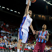 Anadolu Efes's Stratos Perperoglou (L) and Trabzonspor's Demarquis D'Angelo Bost (R) during their Turkish Basketball League Play Off Semi Final round 1 match Anadolu Efes between Trabzonspor at Abdi Ipekci Arena in Istanbul Turkey on Friday 29 May 2015. Photo by Aykut AKICI/TURKPIX