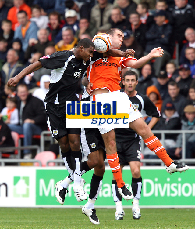 Photo: Paul Greenwood.<br />Blackpool v Bristol City. Coca Cola Championship. 18/08/2007.<br />Bristol's Marvin Elliott (L) gets the better of Ben Burgess in the air