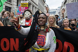 Marvina Newton leads environmental activists from Extinction Rebellion on a Blood Money March through the City of London on the fifth day of Impossible Rebellion protests on 27th August 2021 in London, United Kingdom. Extinction Rebellion were intending to highlight financial institutions funding fossil fuel projects, especially in the Global South, as well as law firms and institutions which facilitate them, whilst calling on the UK government to cease all new fossil fuel investment with immediate effect.