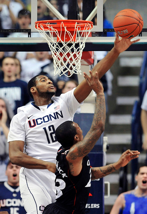 Connecticut's Andre Drummond (12) blocks a shot by Cincinnati's Sean Kilpatrick in the second half of an NCAA college basketball game in Storrs, Conn., Wednesday, Jan. 18, 2012. Cincinnati won 70-67. (AP Photo/Jessica Hill)