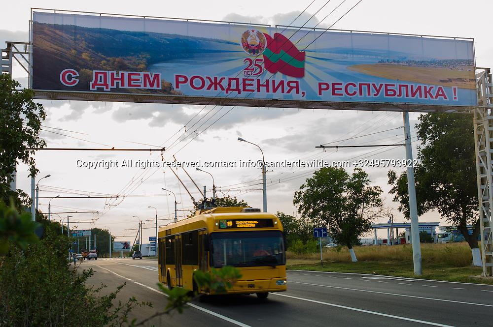 20150826 Tiraspol,  Moldova, Transnistria A trollybus enters Tiraspol from Bender, passing the big sign celebrating the 25th anniversary of the stat of Transnestria, a communist part of Moldova