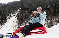 Children playing during Normal Hill Individual Competition at FIS World Cup Ski jumping Ladies Ljubno 2012, on February 11, 2012 in Ljubno ob Savinji, Slovenia. (Photo By Vid Ponikvar / Sportida.com)