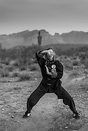 Teach For America 2nd grade teacher Marianne Kelly, a black belt in Kung Fu practices in the desert outside Phoenix, AZ..