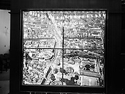 24/01/1962<br /> 01/24/1962<br /> 24 January 1962<br /> Illuminated map at Ulster Bank, College Green, Dublin. A large hand coloured illuminated photograph depicting the principal feature of central Dublin was put on display in Ulster Bank. It was an aerial view of the city centre enlarged to five feet by five feet nine inches from a transparency of 5 by 4 inches. The bank felt that it would be of interest to customers and tourists alike. Photos, Photo, Snap, Streets, Street,
