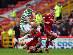 Celtic's Tom Rogic (left) and Aberdeen's David Bates battle for the ball during the cinch Premiership match at Pittodrie Stadium, Aberdeen. Picture date: Sunday October 3, 2021.