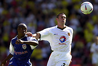 Photo. Richard Page<br />Watford v Millwall. Nationwide Division One. 13/09/2003.<br />Paul Robinson holds off Abou Fofana.