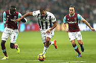 Jose Salomon Rondon of West Bromwich Albion goes past Cheikhou Kouyate of West Ham United (l) . Premier league match, West Ham Utd v West Bromwich Albion at the London Stadium, Queen Elizabeth Olympic Park in London on Saturday 11th February 2017.<br /> pic by John Patrick Fletcher, Andrew Orchard sports photography.