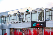 Birmingham, United Kingdom, June 14, 2021: Palestine Action activists appears to be using a sledgehammer to smash windows of Arconic admin offices after they pelted them in red paint on Monday, June 14, 2021. Arconic is an American industrial company specializing in lightweight metals engineering and manufacturing known as Arconic in Bermingham on Monday, June 14, 2021.  (Photo by Vudi Xhymshiti)