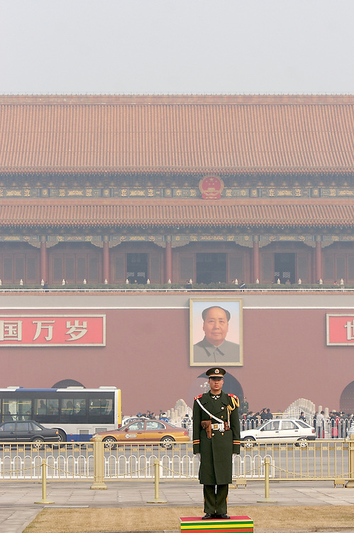 A soldier stands guard at the North side of Tiananmen Square across the street from the southern entrance to the Forbidden City Beijing, China.