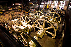 California, San Francisco: Cable Car transportation. Large wheels turn cables at Cable Car Barn. Photo 5-casanf77974. Photo copyright Lee Foster.
