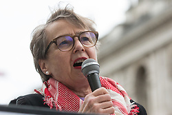 London, UK. 11th May, 2021. Kate Hudson, General Secretary of the Campaign for Nuclear Disarmament (CND), addresses thousands of people attending an emergency rally in solidarity with the Palestinian people organised outside Downing Street by Palestine Solidarity Campaign, Friends of Al Aqsa, Stop The War Coalition and Palestinian Forum in Britain. The rally took place in protest against Israeli air raids on Gaza, the deployment of Israeli forces against worshippers at the Al-Aqsa mosque during Ramadan and attempts to forcibly displace Palestinian families from the Sheikh Jarrah neighbourhood of East Jerusalem.