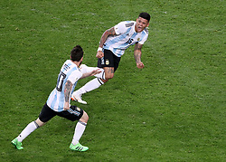 Argentina's Marcos Rojo (top) celebrates scoring his side's second goal of the game with team-mate Argentina's Lionel Messi (left) during the FIFA World Cup Group D match at Saint Petersburg Stadium.