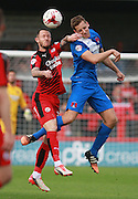 Crawley Town striker Rhys Murphy and Leyton Orient defender Connor Essam compete for a high ball during the Sky Bet League 2 match between Crawley Town and Leyton Orient at the Checkatrade.com Stadium, Crawley, England on 10 October 2015. Photo by Bennett Dean.