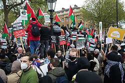 London, UK. 11th May, 2021. Thousands of people hold Palestinian flags and placards at an emergency protest in solidarity with the Palestinian people organised outside Downing Street by Palestine Solidarity Campaign, Friends of Al Aqsa, Stop The War Coalition and Palestinian Forum in Britain. The rally took place in protest against Israeli air raids on Gaza, the deployment of Israeli forces against worshippers at the Al-Aqsa mosque during Ramadan and attempts to forcibly displace Palestinian families from the Sheikh Jarrah neighbourhood of East Jerusalem.