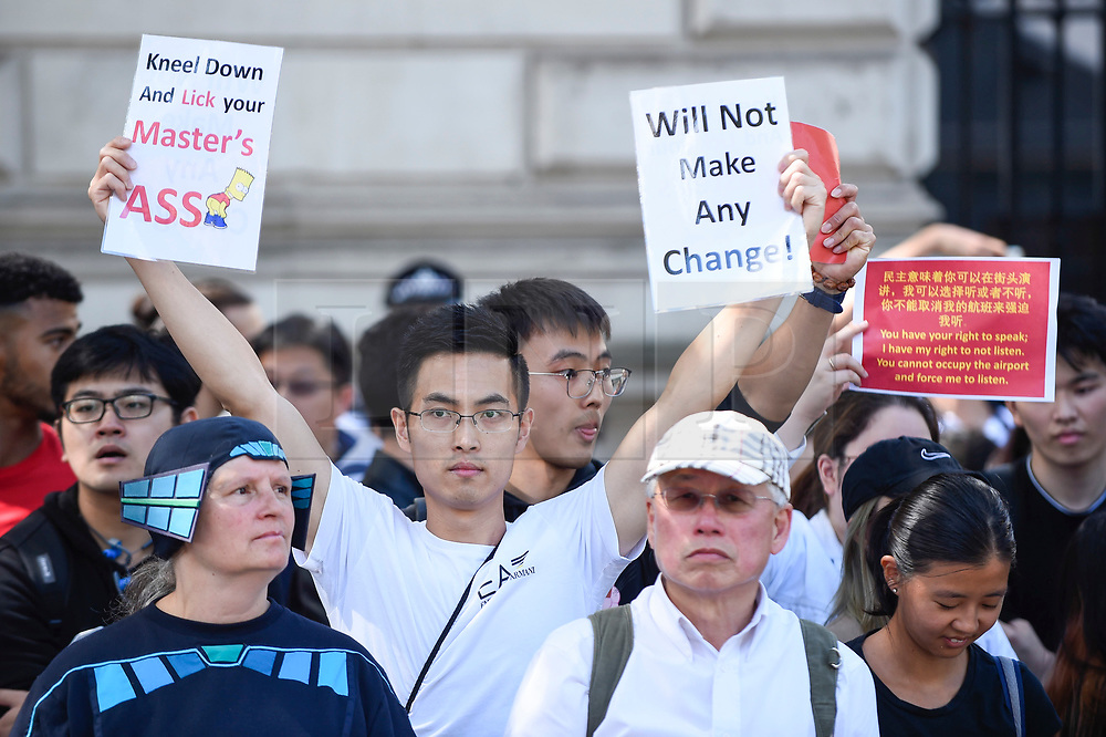 """© Licensed to London News Pictures. 17/08/2019. LONDON, UK.  Pro China demonstrators outside Downing Street take part in a counter protest against a solidarity rally for the people of Hong Kong.  Similar """"Global Solidarity with Hong Kong"""" rallies are taking place worldwide as protests in the former British colony enter their tenth week demanding democratic reforms and a halt to police brutality.  Photo credit: Stephen Chung/LNP"""