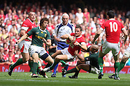 Lee Byrne of Wales is tackled by Ricky Januarie of South Africa. Wales v South Africa,    at Millennium Stadium in Cardiff on Sat 5th June 2010. pic by Andrew Orchard,  Andrew Orchard sports photography,