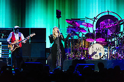 © Licensed to London News Pictures. 27/05/2015. London, UK.   Fleetwood Mac performing live at The O2 Arena, together with Christine Mc Vie who has rejoined the band.   In this picture - John McVie (left), Stevie Nicks (centre), Mick Fleetwood (right).  The band are due to headline the Isle of Wight Festival next month. Fleetwood Mac are a British-American rock band consisting of members Mick Fleetwood (drums), John McVie (bass guitar), Christine McVie (keyboards/vocals), Lindsey Buckingham (guitars, vocals), Stevie Nicks (vocals, tambourine).  Photo credit : Richard Isaac/LNP