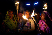Women gas survivors holding torches are demonstrating near the Union Carbide (now DOW Chemical) industrial complex, site of the infamous 1984 gas tragedy in Bhopal, Madhya Pradesh, central India, on the eve of the 29th anniversary since the disaster, December 2, 2013. The poisonous cloud that enveloped Bhopal left everlasting consequences that today continue to consume people's lives.