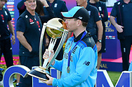 Eoin Morgan of England kisses the Cricket World Cup trophy as he celebrates his team becoming World Champions during the ICC Cricket World Cup 2019 Final match between New Zealand and England at Lord's Cricket Ground, St John's Wood, United Kingdom on 14 July 2019.