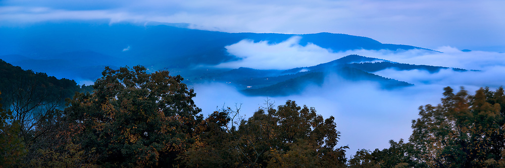 The Blue Ridge Mountains are shrouded in fog in the late evening. Shenandoah National Park, as seen from along Skyline Drive.