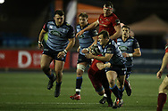 Jarrod Evans, the outside half of Cardiff Blues © looks to make a break through the Munster defence . .  Guinness Pro14 rugby match, Cardiff Blues v Munster Rugby at the Cardiff Arms Park in Cardiff, South Wales on Saturday 17th February 2018.<br /> pic by Andrew Orchard, Andrew Orchard sports photography.