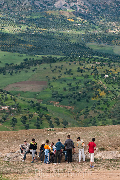 Moroccan boys with view of the countryside in Fes, Morocco