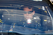 Jeff Gordon sits in his car before a practice run for a NASCAR Sprint Cup series auto race, Friday, May 9, 2014, at Kansas Speedway in Kansas City, Kan. (AP Photo/Colin E. Braley)