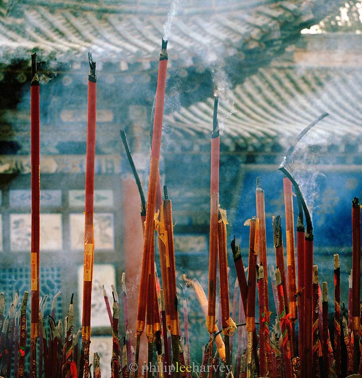 Incense sticks burning at Buddhist Temple, Silk Route; Dunhuang, Jiuquan, Gansu Province, China.