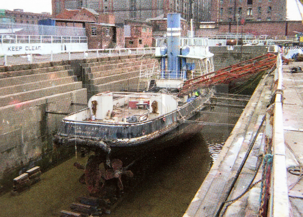 """© Licensed to London News Pictures. 04/05/2016. Birkenhead UK. Collect picture shows the Daniel Adamson looking in a sorry state at Clarence dry docks in 2004. The Daniel Adamson steam boat has been bought back to operational service after a £5M restoration. The coal fired steam tug is the last surviving steam powered tug built on the Mersey and is believed to be the oldest operational Mersey built ship in the world. The """"Danny"""" (originally named the Ralph Brocklebank) was built at Camel Laird ship yard in Birkenhead & launched in 1903. She worked the canal's & carried passengers across the Mersey & during WW1 had a stint working for the Royal Navy in Liverpool. The """"Danny"""" was refitted in the 30's in an art deco style. Withdrawn from service in 1984 by 2014 she was due for scrapping until Mersey tug skipper Dan Cross bought her for £1 and the campaign to save her was underway. Photo credit: Andrew McCaren/LNP ** More information available here http://tinyurl.com/jsucxaq **"""