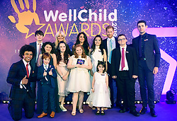 The Duke and Duchess of Sussex pose for a group photograph with award winners and presenters during the annual WellChild Awards at the Royal Lancaster Hotel, London.
