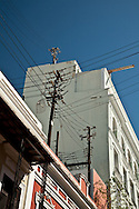 To maintain the historic look of the main streets of Old San Juan, the electric wiring is run on roof-top poles.