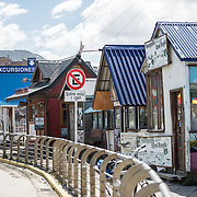 A row of small tour and expedition guide offices offering local tours and adventures. These offices are located along the waterfront of Ushuaia Port.
