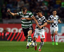 LISBON, April 23, 2018  Stefan Ristovski (L) of Sporting vies with Rochinha of Boavista during Portuguese League soccer match between Sporting CP and Boavista FC in Lisbon, Portugal, on April 22, 2018. Sporting won 1-0.  wll) (Credit Image: © Zhang Liyun/Xinhua via ZUMA Wire)