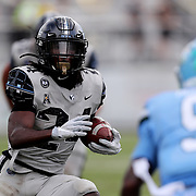 ORLANDO, FL - OCTOBER 24: Running back Bentavious Thompson #24 of the Central Florida Knights runs the ball against cornerback Jaylon Monroe #9 of the Tulane Green Wave at Bounce House-FBC Mortgage Field on October 24, 2020 in Orlando, Florida. (Photo by Alex Menendez/Getty Images) *** Local Caption *** Bentavious Thompson