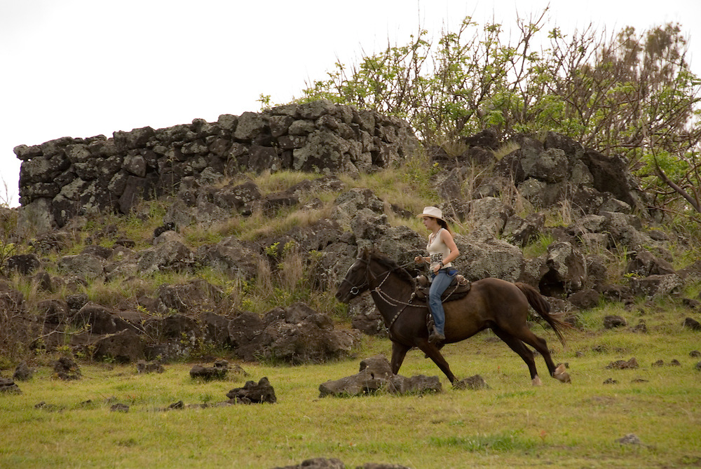 Chile, Easter Island: Horse riders galloping at Ahu Tahai near Hanga Roa..Photo #: ch236-33127..Photo copyright Lee Foster www.fostertravel.com lee@fostertravel.com 510-549-2202