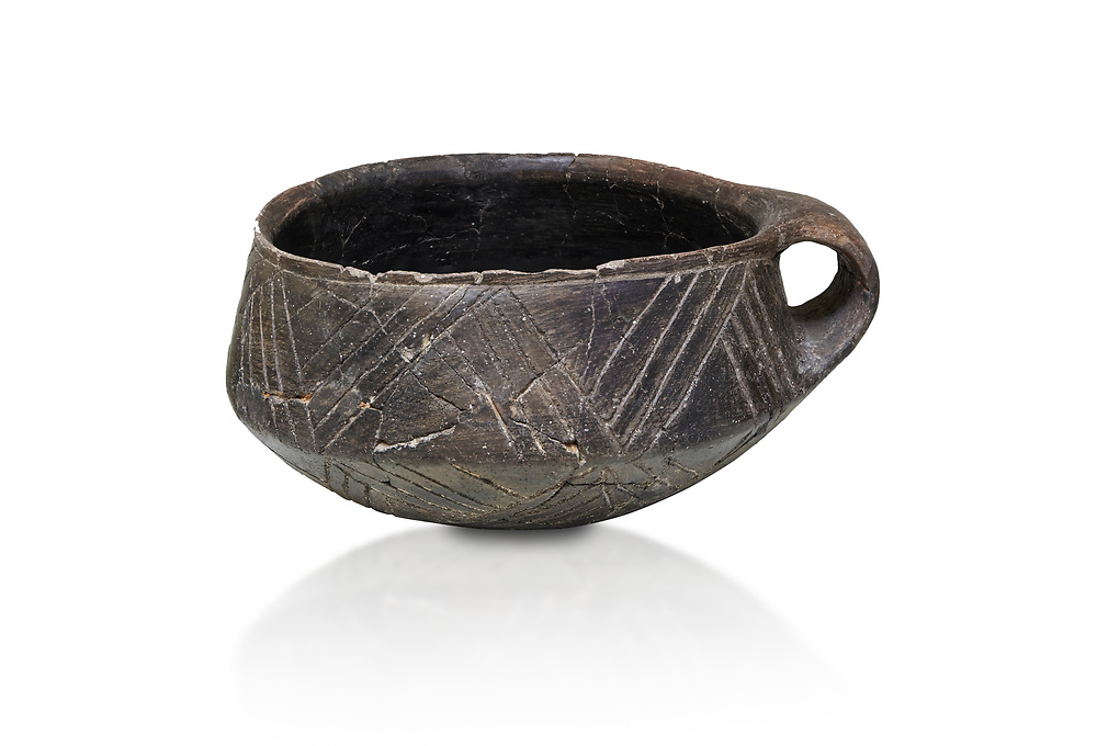 Neolithic Cretian clay single handled cup open kiln fired at Knossos,  4500-3000 BC, Heraklion Archaeological  Museum, white background. .<br /> <br /> If you prefer to buy from our ALAMY PHOTO LIBRARY  Collection visit : https://www.alamy.com/portfolio/paul-williams-funkystock/minoan-art-artefacts.html . Type -   Heraklion   - into the LOWER SEARCH WITHIN GALLERY box. Refine search by adding background colour, place, museum etc<br /> <br /> Visit our MINOAN ART PHOTO COLLECTIONS for more photos to download  as wall art prints https://funkystock.photoshelter.com/gallery-collection/Ancient-Minoans-Art-Artefacts-Antiquities-Historic-Places-Pictures-Images-of/C0000ricT2SU_M9w
