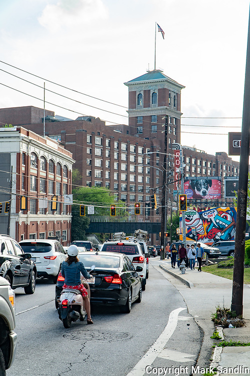 Street view of Ponce De Leon Ave, Atlanta, GA. Atlanta Beltline crossing over street. Ponce City Market in background