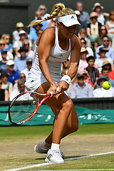 © Licensed to London News Pictures. 07/07/2016.  ANGELIQUE KERBER wins her semi-finals single ladies match against  VENUS WILLIAMS on the eleventh day of the WIMBLEDON Lawn Tennis Championships. London, UK. Photo credit: Ray Tang/LNP
