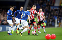 Lincoln City's Harry Anderson (centre) and Everton's Leighton Baines battle for the ball during the Emirates FA Cup, third round match at Goodison Park, Liverpool.