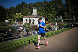 © Licensed to London News Pictures. 10/08/2021. A man jogging in the warm weather in Hyde Park, central London. A period of warmer conditions is expected across the UK following several days of torrential rain. Photo credit: Ben Cawthra/LNP