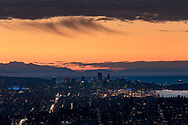 View of the City of Vancouver from Burnaby Mountain after sunset. Mount Arrowsmith is on the left, then downtown Vancouver, and the west end with English Bay's ships beyond. Photographed from Burnaby Mountain Conservation Area in Burnaby, British Columbia, Canada.