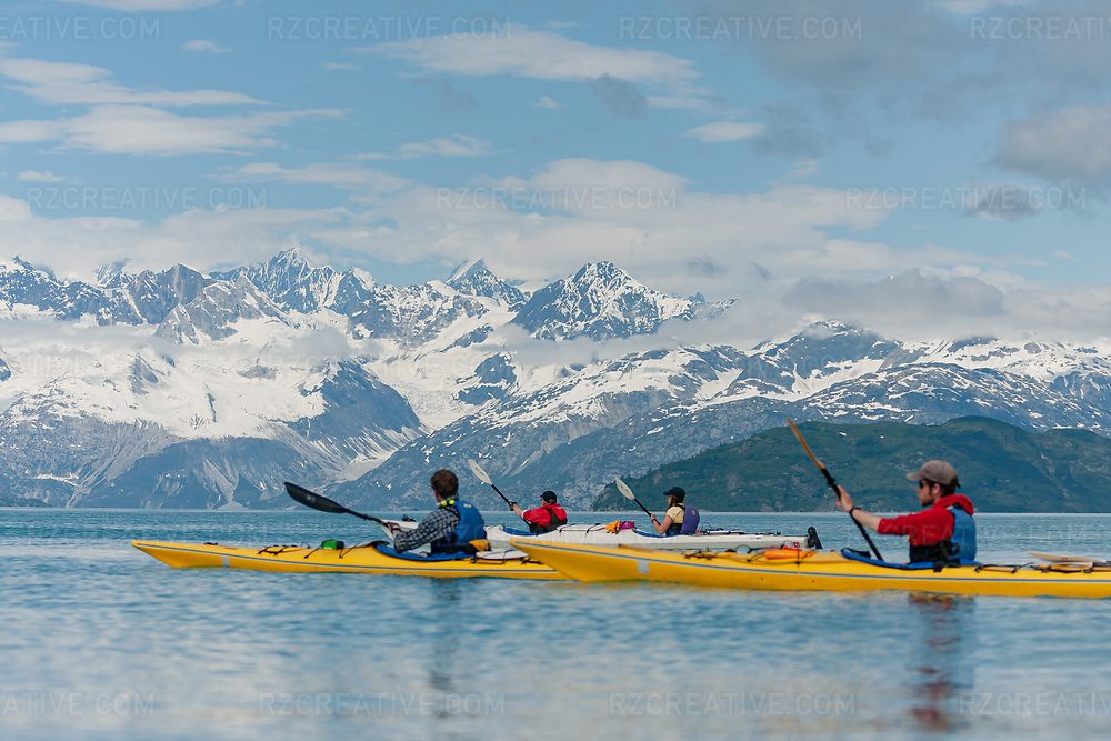 Sea kayakers paddling in the West Arm of Glacier Bay National Park in Alaska. Photo © Robert Zaleski / rzcreative.com<br /> —<br /> To license this image contact: robert@rzcreative.com