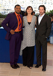 Actors from left to right; Laurence Fishburne, Carrie-Anne Moss and Keanu Reeves pose for photographers during a photocall to promote their new film The Matrix Reloaded at the Palias des Festival as part of the 56th Cannes Film Festival in southern France.