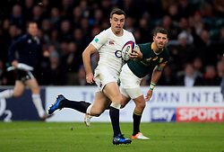 England's George Ford goes through to score his side's third try during the Autumn International match at Twickenham Stadium, London.