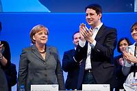 16 OCT 2010, POTSDAM/GERMANY:<br /> Angela Merkel (L), CDU, Bundeskanzlerin, Philipp Missfelder (R), MdB, Bundesvorsitzender Junge Union, Deutschlandtag der Jungen Union, Metropolis Halle, Filmpark Babelsberg<br /> IMAGE: 20101016-01-084<br /> KEYWORDS: Parteitag, party congress, Bundesparteitag, Philipp Mißfelder, Applaus, klatschen, applaudieren